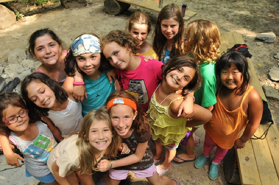 Young campers pose together at Camp Livingston, one of the many Jewish summer camps that allows Jewish youth to build connections and a community of their own.